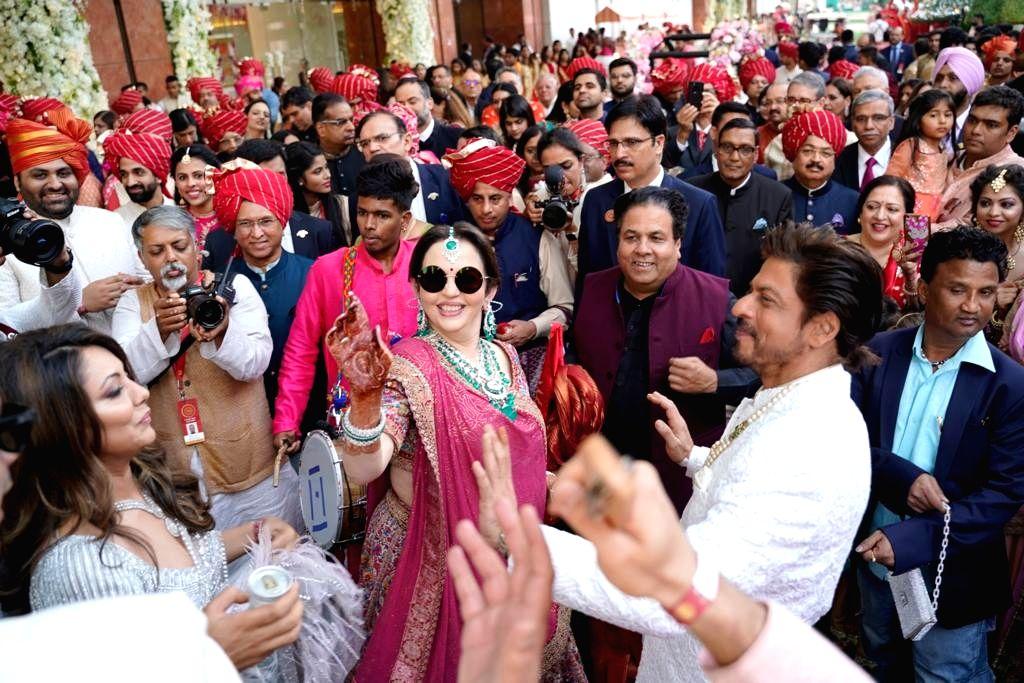 Mumbai: Actor Shah Rukh Khan and Nita Ambani at the wedding festivities of Akash Ambani and Shloka Mehta in Mumbai on March 9, 2019. (Photo: IANS) - Shah Rukh Khan, Nita Ambani, Akash Ambani and Shloka Mehta