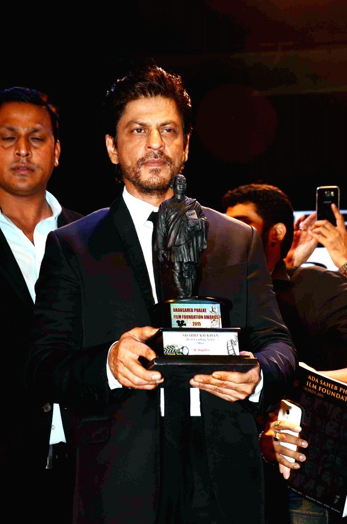 "Actor Shah Rukh Khan receives Dadasaheb Phalke Film Foundation Award 2015 for his performance in the 2014 film ""Happy New Year"" in Mumbai, on April 22, 2015. - Shah Rukh Khan"