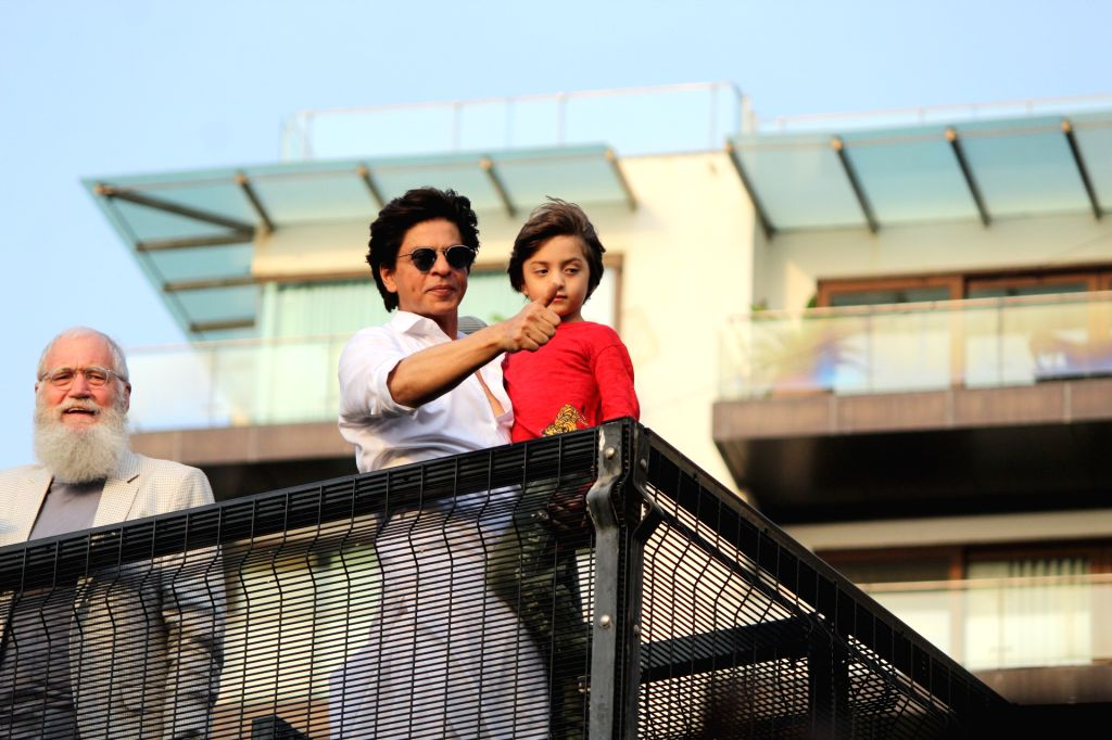 Mumbai: Actor Shahrukh Khan and his son AbRam Khan during a fan meet from the balcony of Mannat on Eid-ul-Fitr celebrations, in Mumbai, on June 5, 2019. (Photo: IANS) - Shahrukh Khan