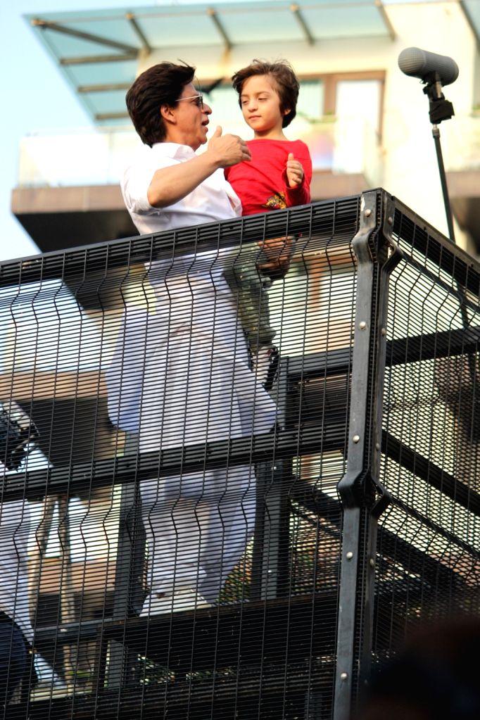 Mumbai: Actor Shahrukh Khan and his son AbRam Khan during a fan meet from the balcony of Mannat on Eid-ul-Fitr celebrations, in Mumbai, on June 5, 2019. (Photo: IANS) - Shahrukh Khan