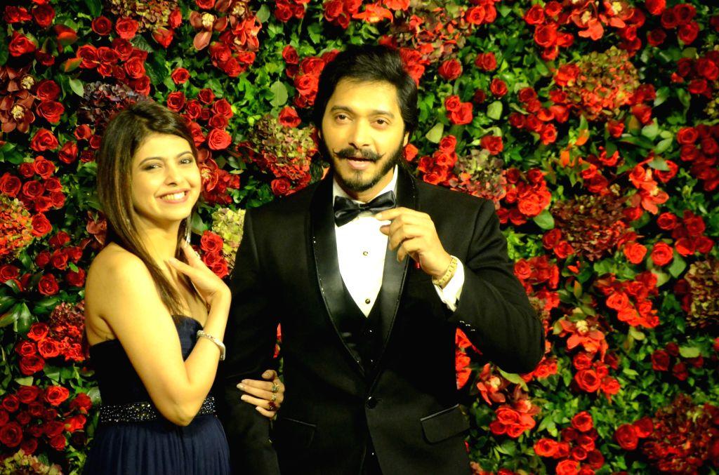 Mumbai: Actor Shreyas Talpade at the wedding reception of actors Ranveer Singh and Deepika Padukone in Mumbai, on Dec 1, 2018. (Photo: IANS) - Shreyas Talpade, Ranveer Singh and Deepika Padukone