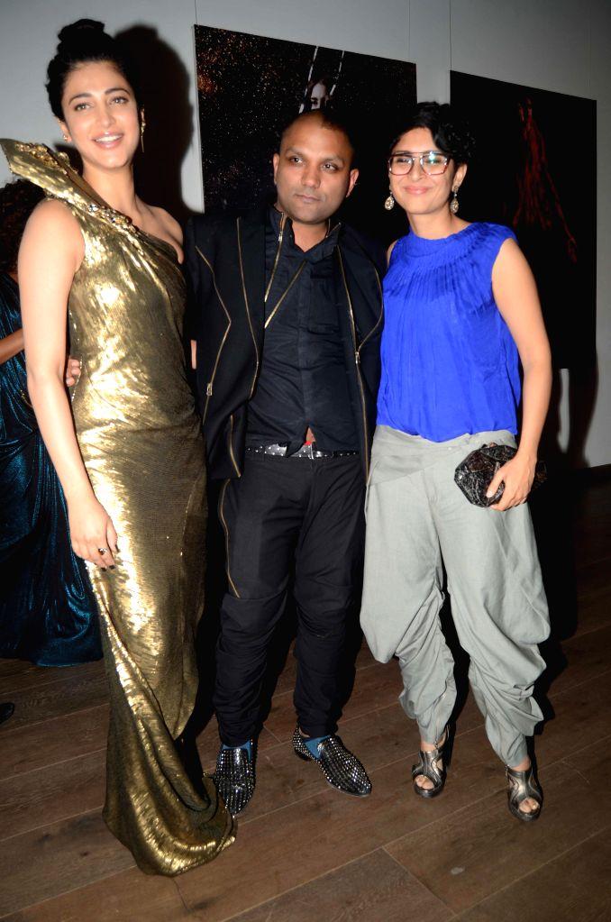 Actor Shruti Hasan, Fashion designer Gaurav Gupta with Bollywood filmmaker Kiran Rao during the opening of his store in Mumbai on Nov 27, 2014. - Shruti Hasan and Kiran Rao