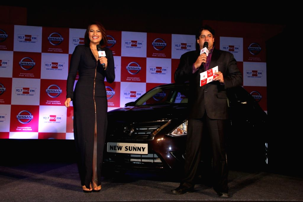 Actor Sonakshi Sinha and Television anchor and comedian Cyrus Broacha during the partnership between Nissan Sunny Sedan and 92.7 Big FM wherein listeners will get to enjoy extra content, ...