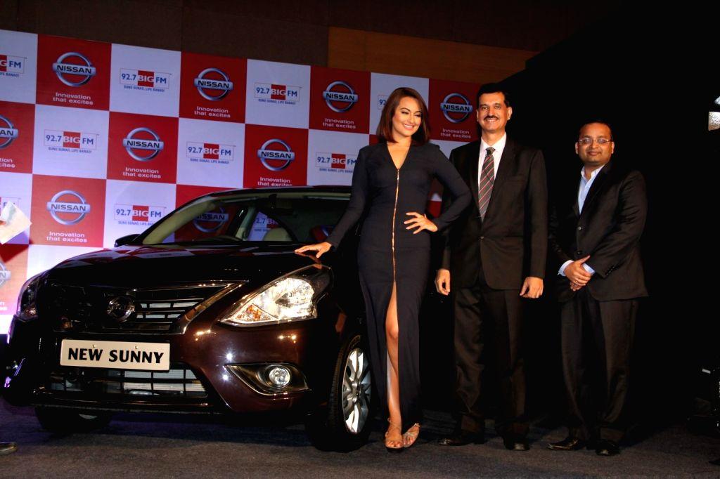Actor Sonakshi Sinha, Arun Malhotra, MD, NMIPL and Ashwin Padmanabhan, National Bisiness Head- 92.7 BIG FM during the partnership between Nissan Sunny Sedan and 92.7 Big FM wherein listeners ... - Arun Malhotra