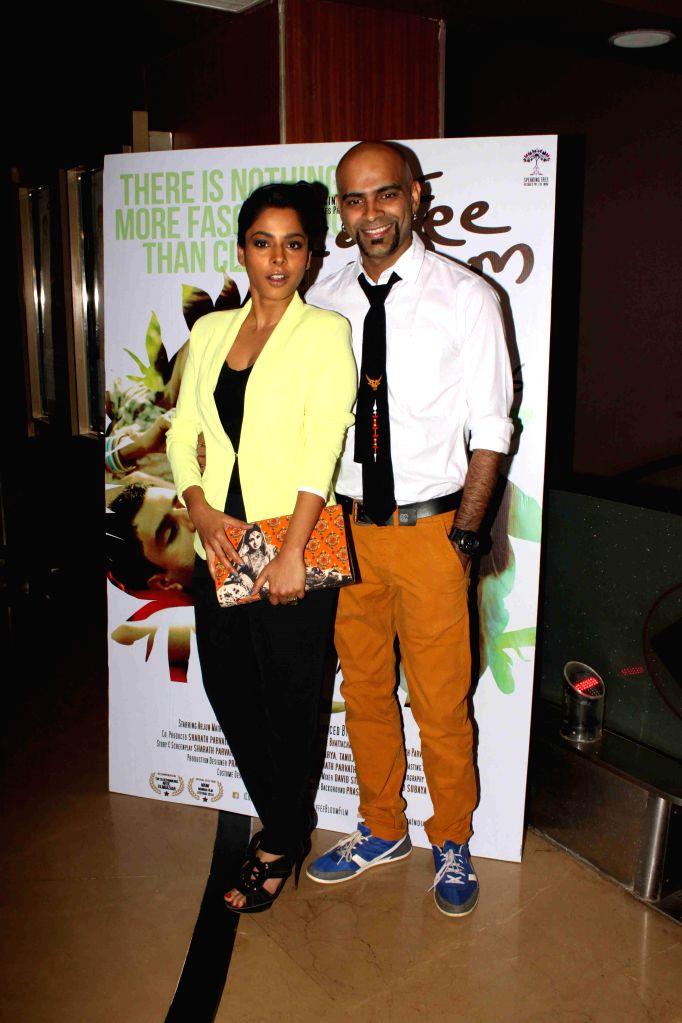 Actor Sugandha Garg with husband Raghu Ram during screening film Coffee Bloom in Mumbai on March 5, 2015. - Sugandha Garg