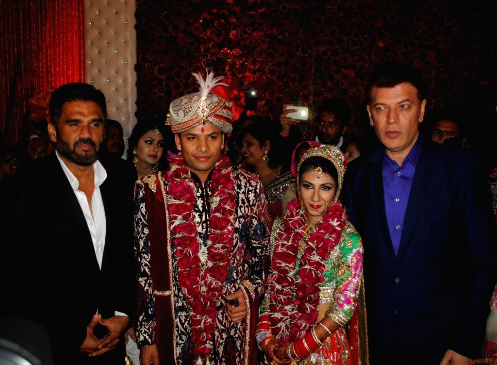 Actor Sunil Shetty with Atin, Lalita and Aditya Pancholi snapped at producer Krishna Choudhary's daughter's wedding in Mumbai on 12th February 2013 . - Sunil Shetty