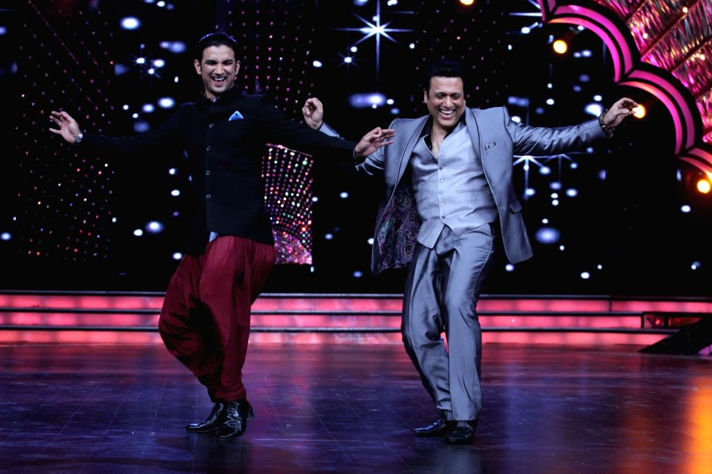 Actor Sushant Sigh Rajput shaking legs with judge Govindaduring the promotion of film Detective Byomkesh Bakshi on the sets of Zee TV`s, reality show, Dance India Dance Super Moms in Mumbai, ... - Sushant Sigh Rajput