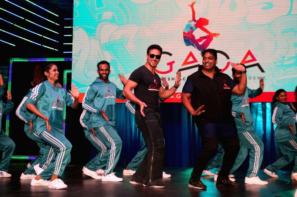 Mumbai: Actor Tiger Shroff at choreographer Ganesh Acharya's dance academy launch in Mumbai, on Jan 22, 2019. (Photo: IANS) - Tiger Shroff