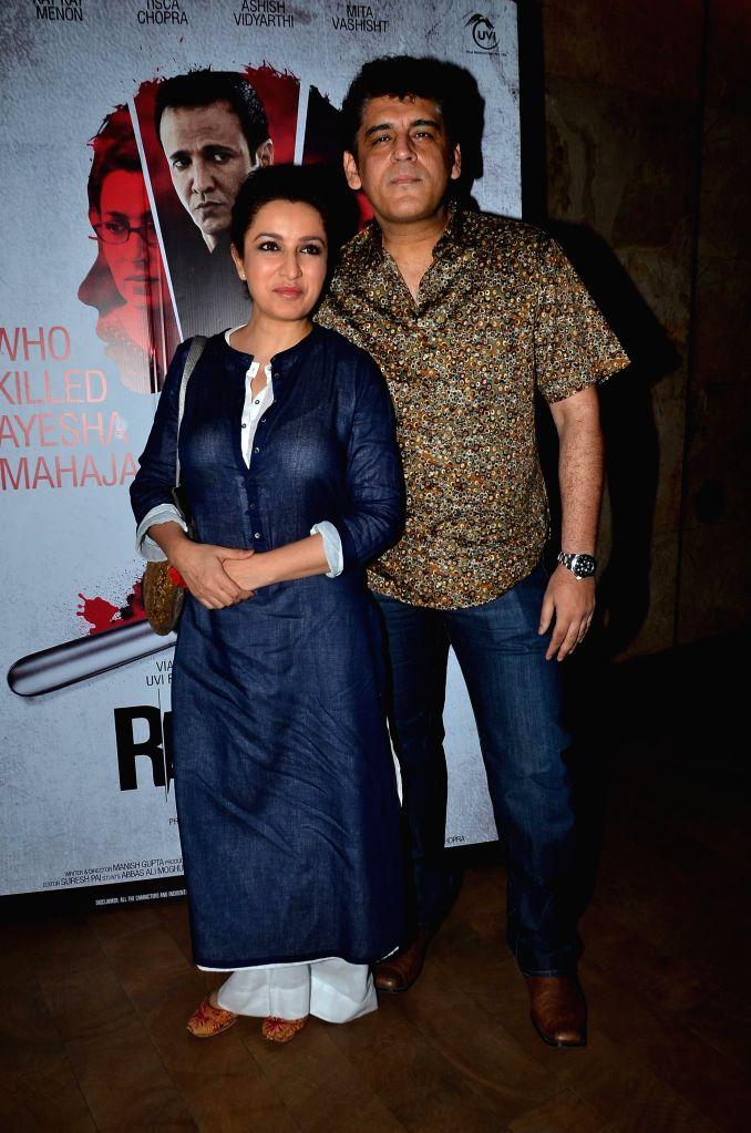 Actor Tisca Chopra along with her husband Captain Sanjay Chopra during the screening of film Rahasya, in Mumbai on Jan. 30, 2015. - Tisca Chopra and Sanjay Chopra
