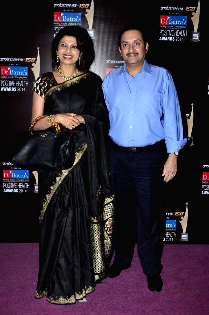 Actor Varsha Usgaonkar along with her husband Ajay Shankar during the Dr Batra's 9th Positive Health awards 2014, Mumbai on Nov 13, 2014. - Varsha Usgaonkar