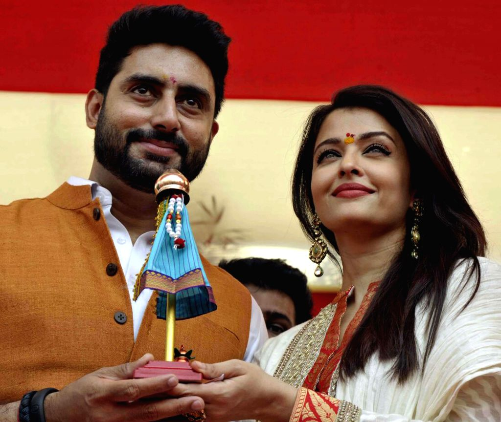 Actors Aishwarya Rai Bachchan and Abhishek Bachchan celebrate Gudhi Padwa during a rally organised by MNS in Mumbai on March 21, 2015.