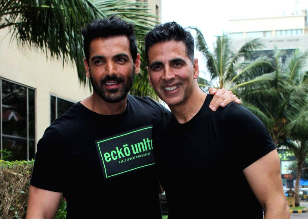 "Mumbai: Actors Akshay Kumar and John Abraham during the joint promotions of their upcoming films ""Mission Mangal"" and ""Batla House"" respectively, in Mumbai on Aug 9, 2019. (Photo: IANS) - Akshay Kumar and John Abraham"