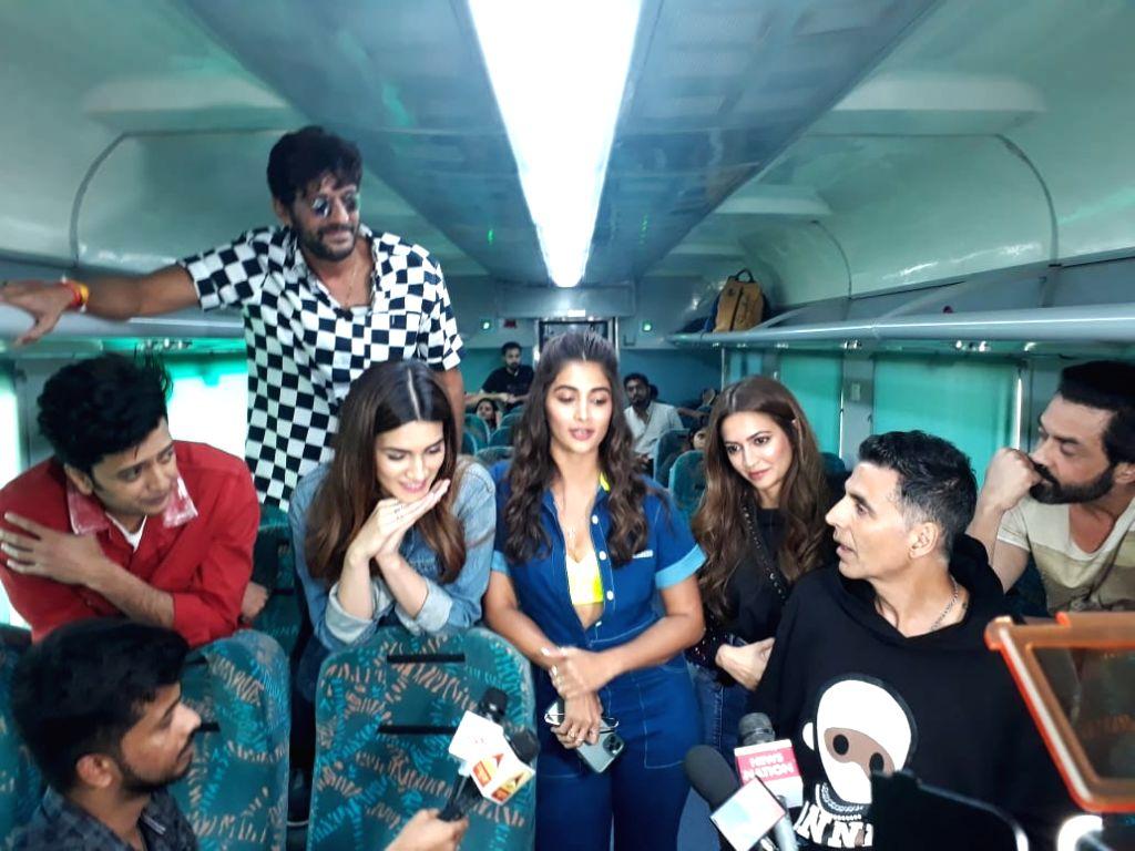 "Mumbai: Actors Akshay Kumar, Riteish Deshmukh, Bobby Deol, Kriti Sanon, Pooja Hegde, Kriti Kharbanda and Chunky Panday travel by a special promotional train from Mumbai to Delhi as part of 'Housefull4Express' rail journey during ""Housefull 4"" promoti - Akshay Kumar, Riteish Deshmukh, Bobby Deol, Kriti Sanon, Pooja Hegde, Kriti Kharbanda and Chunky Panday"