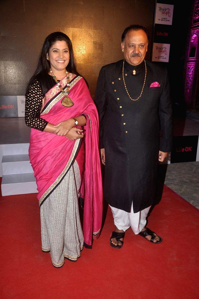 Actors Alok Nath and Renuka Shahane during the launch of Life Ok`s television serial Mere Rang Mein Rangne Wali in Mumbai, on November 13, 2014. - Alok Nath and Renuka Shahane