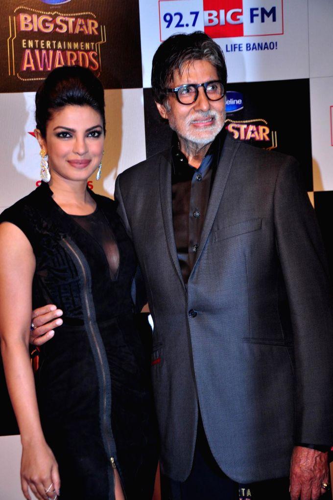 Actors Amitabh Bachchan and Priyanka Chopra during the Big Star Entertainment Awards 2014 in Mumbai on Dec 18, 2014. - Amitabh Bachchan and Priyanka Chopra