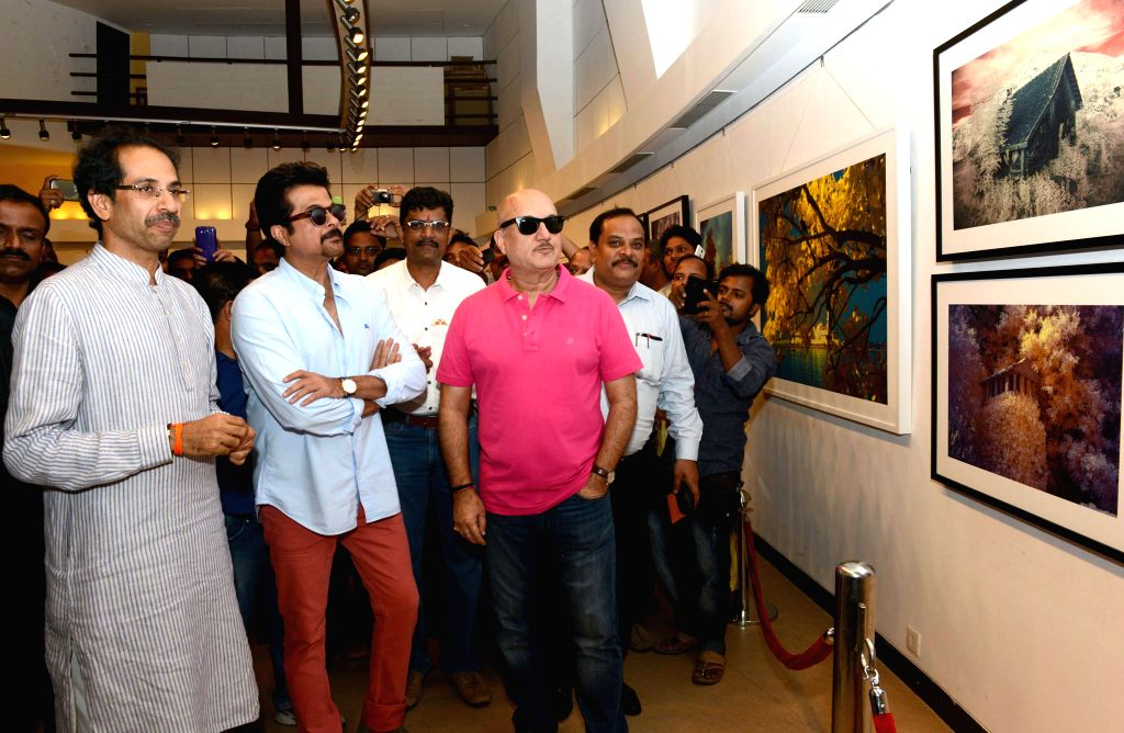 Actors Anil Kapoor and Anupam Kher with Shiv Sena Chief Uddhav Thackeray at his photography exhibition organised to raise funds for drought affected farmers, in Mumbai, on Jan 10, 2015. - Anil Kapoor and Anupam Kher