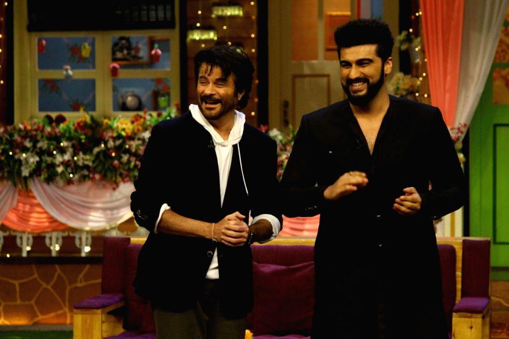 "Mumbai: Actors Anil Kapoor and Arjun kapoor during the promotion of their upcoming film ""Mubarakan"" on the set of ""The Kapil Sharma Show"" in Mumbai, on July 26, 2017. (Photo: IANS) - Anil Kapoor and Arjun"