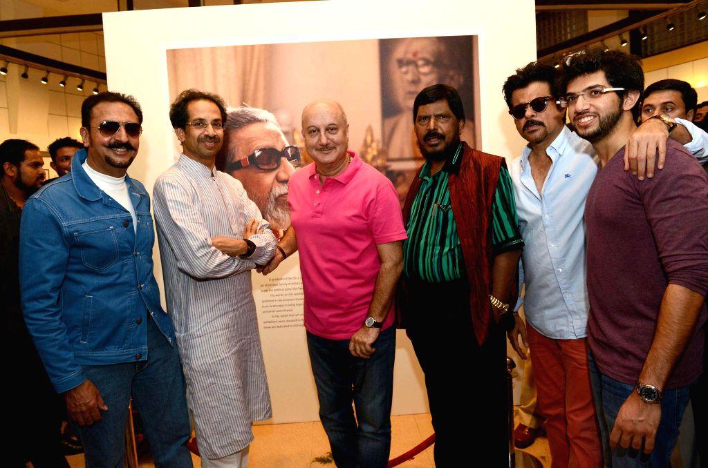 Actors Anil Kapoor, Gulshan Grover, Anupam Kher with Shiv Sena Chief Uddhav Thackeray, RPI chief Ramdas Athawale and Yuva Sena chief Aditya Thackeray at Uddhav Thackeray's photography ... - Anil Kapoor, Gulshan Grover and Anupam Kher