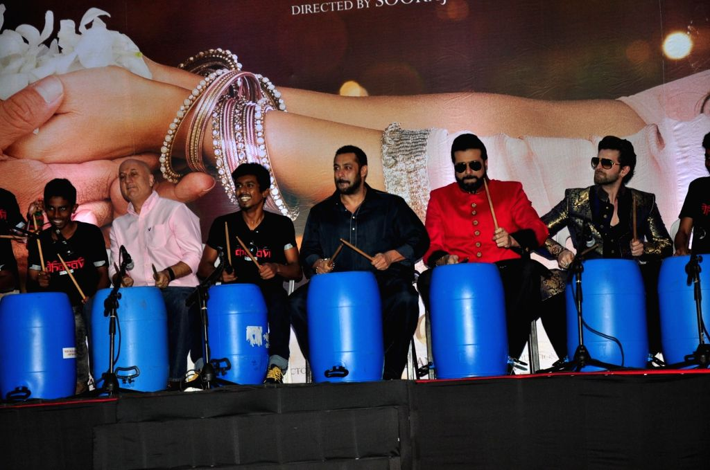 Mumbai: Actors Anupam Kher, Salman Khan, Arman Kohli and Neil Nitin Mukesh celebrate Diwali with Dharavi Rocks, a band of kids who make music out of waste materials in Mumbai on Nov 11, 2015. (Photo: IANS) - Anupam Kher, Salman Khan, Arman Kohli and Neil Nitin Mukesh