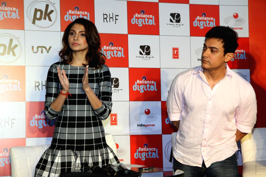 Actors Anushka Sharma and Aamir Khan during the launch of official mobile game PK, in Mumbai on Dec. 12, 2014. - Anushka Sharma and Aamir Khan