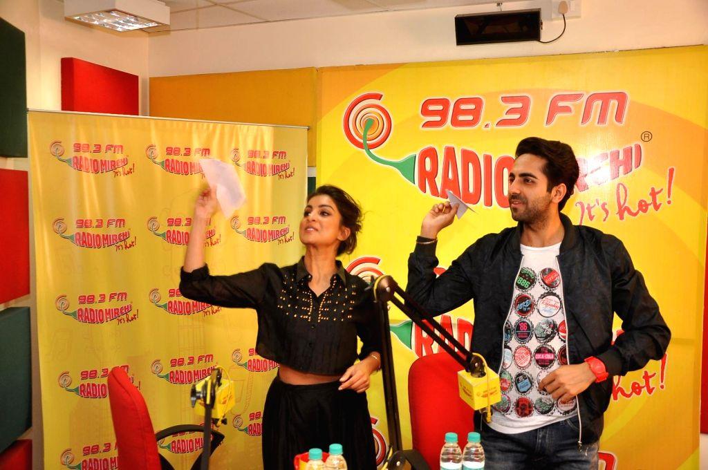 Actors Ayushmann Khurrana and Pallavi Sharda at Radio Mirchi studio for promotion of their upcoming film Hawaizaada in Mumbai, on Jan 08, 2015. - Ayushmann Khurrana and Pallavi Sharda