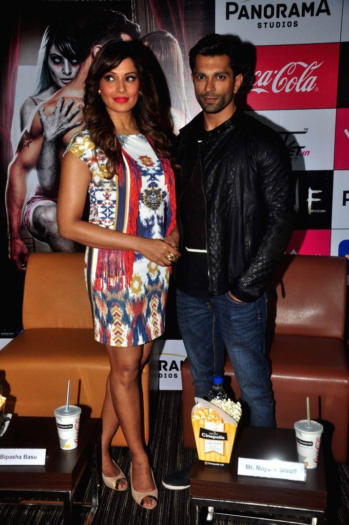 Actors Bipasha Basu and Karan Singh Grover during the promotion of film Alone in Mumbai, on jan. 09, 2015. - Bipasha Basu and Karan Singh Grover