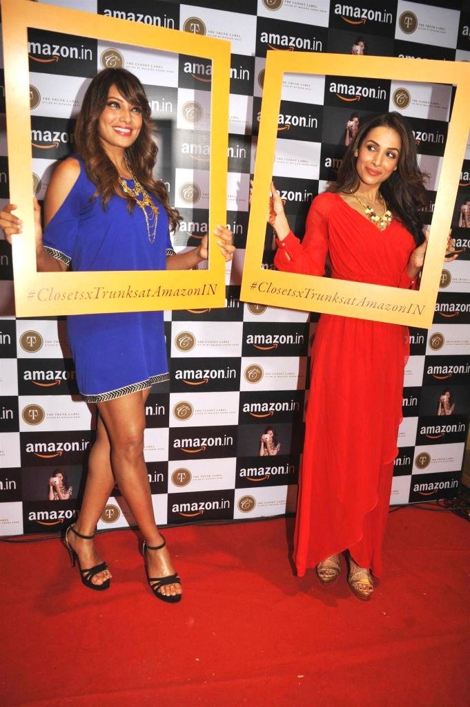 Actors Bipasha Basu and Malaika Arora Khan during the announcement of partnership between Amazon.in and The Label Corp in Mumbai, on Nov 19, 2014. - Bipasha Basu and Malaika Arora Khan