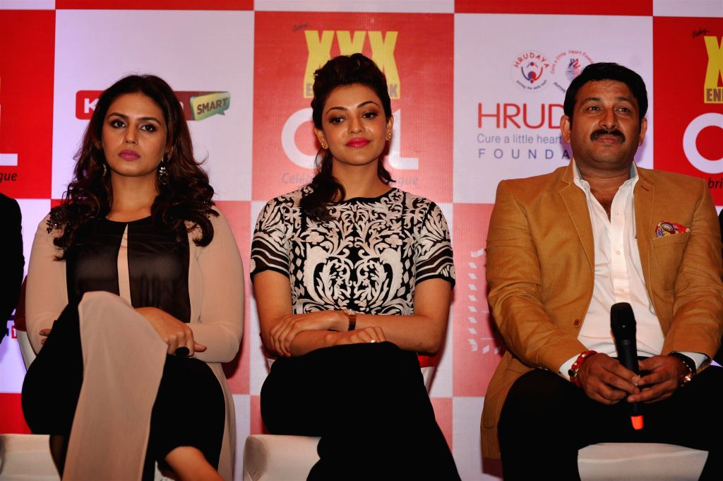 Actors Huma Qureshi, Kajal Aggarwal and Bhojpuri film actor and BJP Member of Parliament Manoj Tiwari during the launch of 100 hearts, a social initiative by Celebrity Cricket League (CCL) ... - Huma Qureshi, Kajal Aggarwal and Bhojpuri