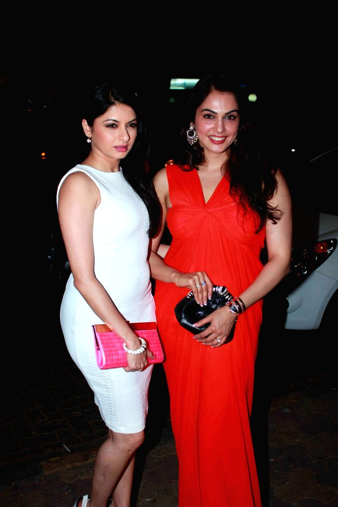 Actors Isha Koppikar and Bhagyashree Patwardhan during the unveiling of latest Trousseau Treasures collection by Maheka Mirpuri at Ghanasingh Be True Store in Mumbai, on Feb 11, 2015. - Isha Koppikar and Bhagyashree Patwardhan