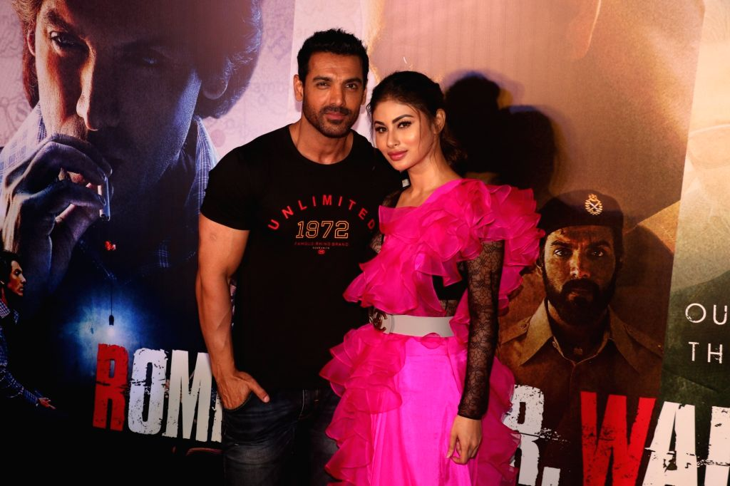 "Mumbai: Actors John Abraham and Mouni Roy at the trailer launch of their upcoming film ""Romeo Akbar Walter"", in Mumbai, on March 4, 2019. (Photo: IANS) - John Abraham and Mouni Roy"