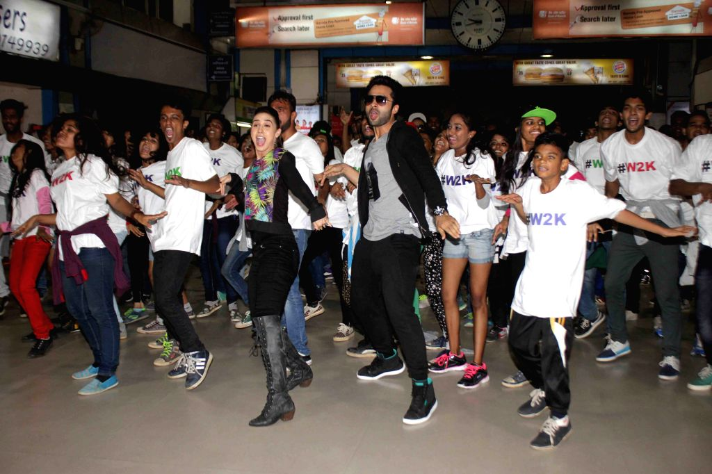 Actors Lauren Gottlieb and Jackky Bhagnani perform a flash mob to promote their film Welcome to Karachi at Churchgate station in Mumbai, on May 23, 2015. - Lauren Gottlieb and Jackky Bhagnani