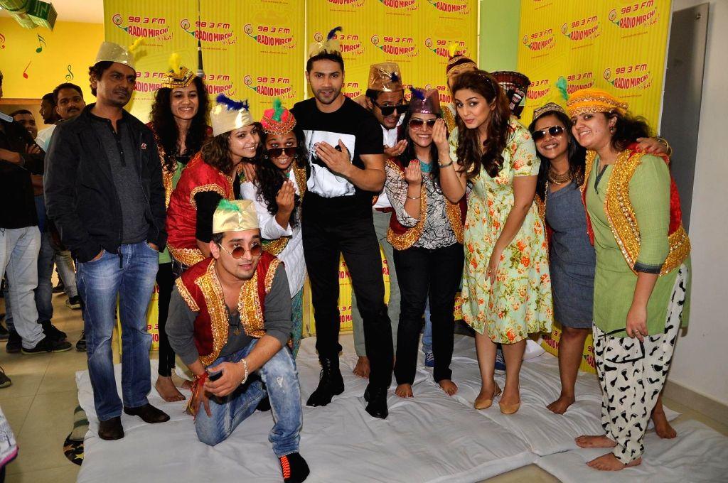 Actors Nawazuddin Siddiqui, Varun Dhawan and Huma Qureshi during promotion of their upcoming movie Badlapur in Mumbai on Jan 17, 2015. - Nawazuddin Siddiqui, Varun Dhawan and Huma Qureshi