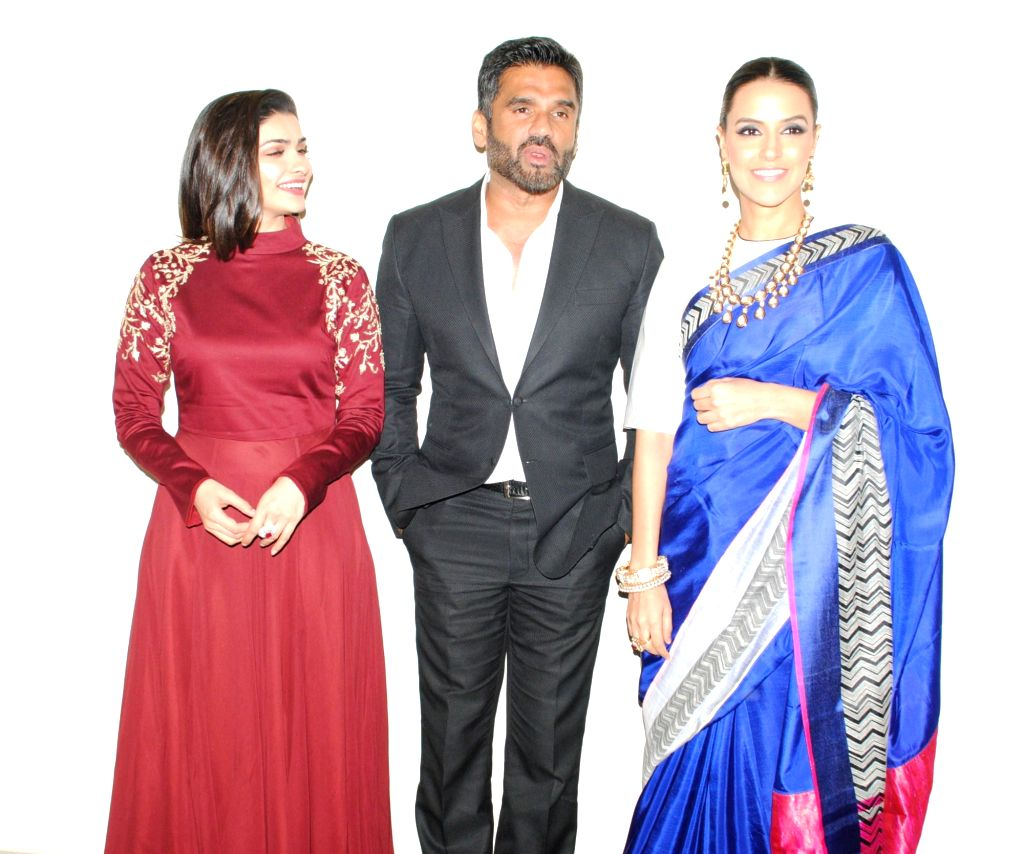 Actors Prachi Desai, Sunil Shetty and Neha Dhupia.snapped at producer Krishna Choudhary's daughter's wedding in Mumbai on 12th February 2013 . - Prachi Desai, Sunil Shetty and Neha Dhupia
