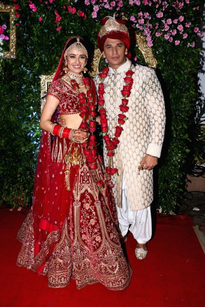 :Mumbai: Actors Prince Narula and Yuvika Chaudhary during their wedding ceremony in Mumbai on Oct 12, 2018. (Photo: IANS).