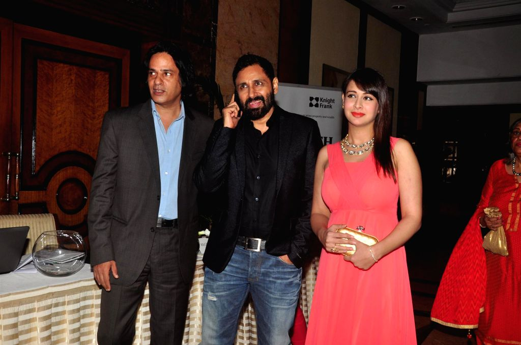 Actors Rahul Roy, Parvin Dabas along with his wife Preeti Jhangiani during the Anmol Jewellers fashion show `Era of Design`, in Mumbai on April 10, 2015. - Rahul Roy and Parvin Dabas