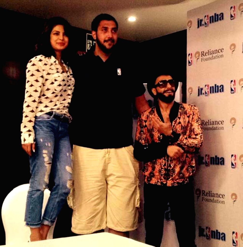 Actors Ranveer Singh and Priyanka Chopra meet Gursimran 'Sim' Bhullar of the Sacramento Kings in Mumbai on May 2, 2015.