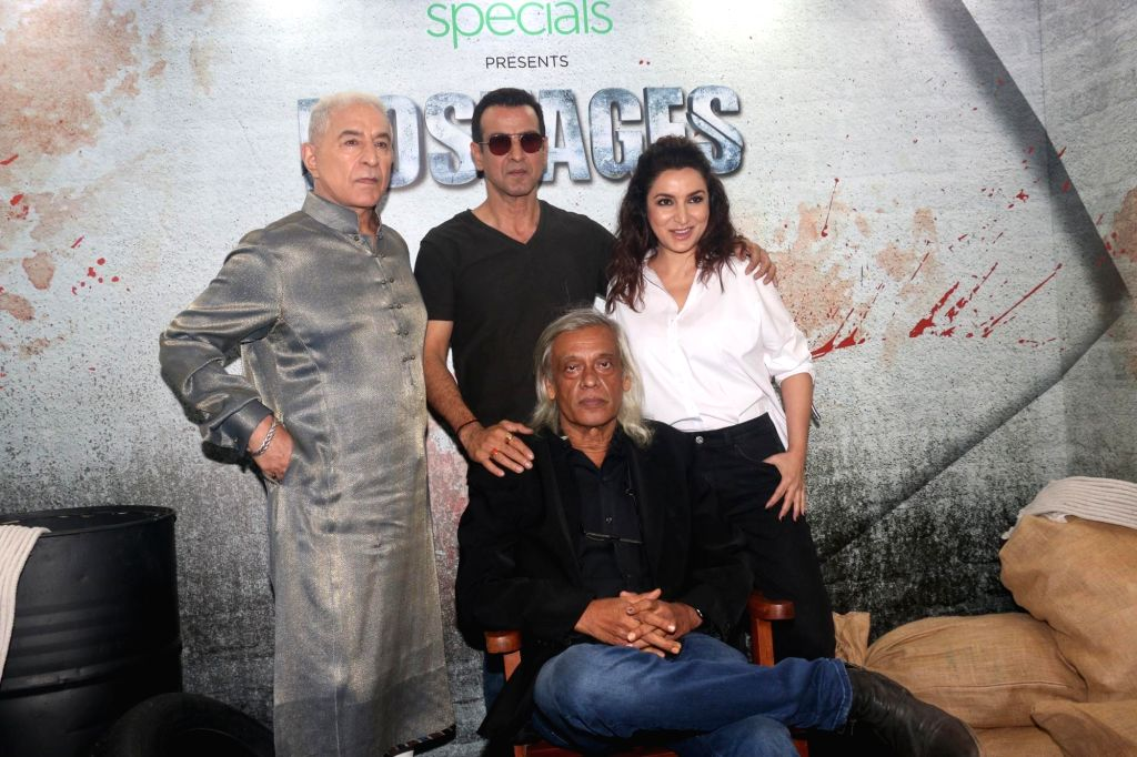Mumbai: Actors Ronit Roy, Dalip Tahil and Tisca Chopra with director Sudhir Mishra at the screening of their upcoming web series 'Hostages', in Mumbai, on May 22, 2019. (Photo: IANS) - Sudhir Mishra, Ronit Roy, Dalip Tahil and Tisca Chopra