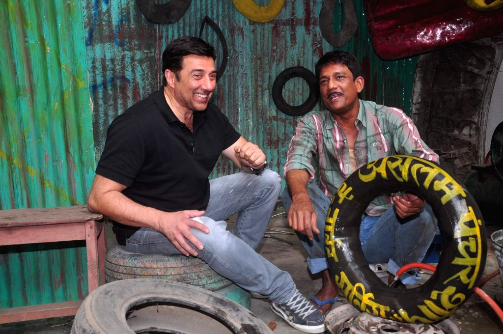 Actors Sunny Deol and Adil Hussain during the promotion of the film Zed Plus, in Mumbai on Nov 25, 2014. - Sunny Deol and Adil Hussain