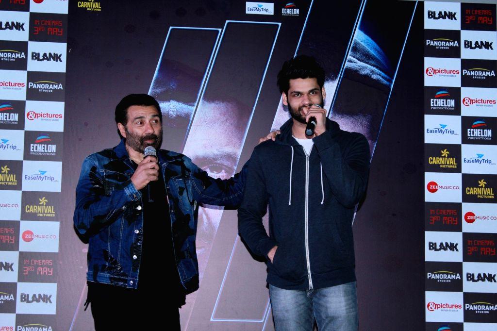 """Mumbai: Actors Sunny Deol and Karan Kapadia address at the trailer launch of their upcoming film """"Blank"""" in Mumbai, on April 4, 2019. (Photo: IANS) - Sunny Deol and Karan Kapadia"""