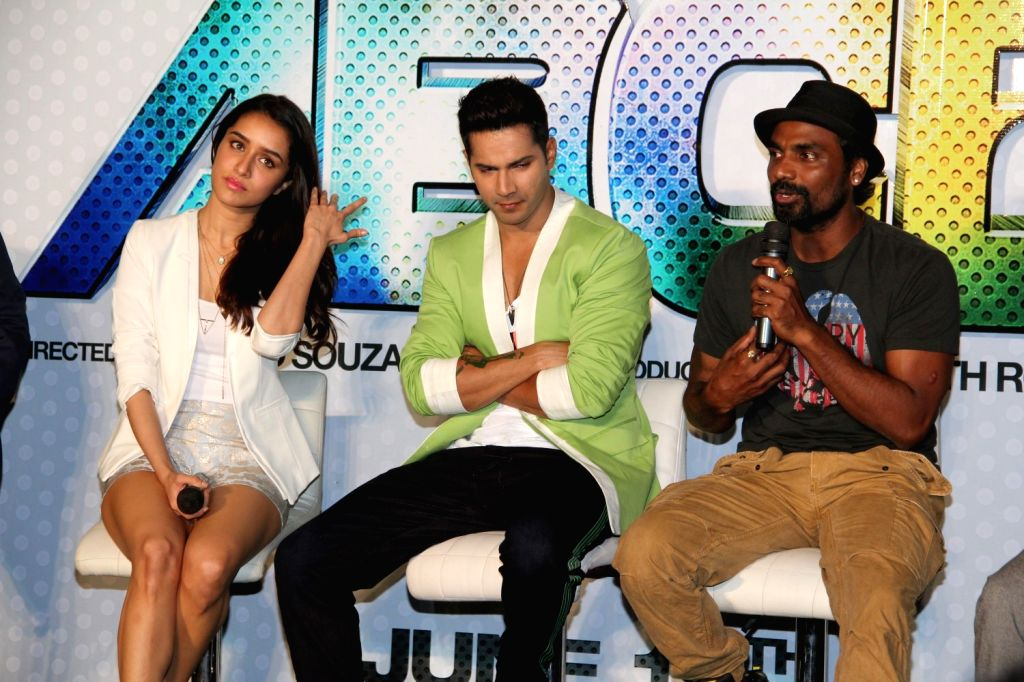 Actors Varun Dhavan, Shraddha Kapoor, filmmaker and choreographer Remo D'Souza during the trailer launch of film Any Body Can Dance 2 (ABCD 2) in Mumbai, on April 23, 2015. - Varun Dhavan and Shraddha Kapoor