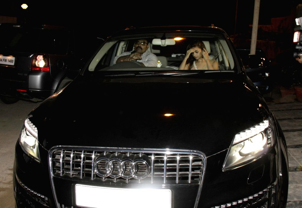 Actress Alia Bhatt spotted travelling at midnight in her Audi Q7 car in Mumbai, Feb 18th, 2015.