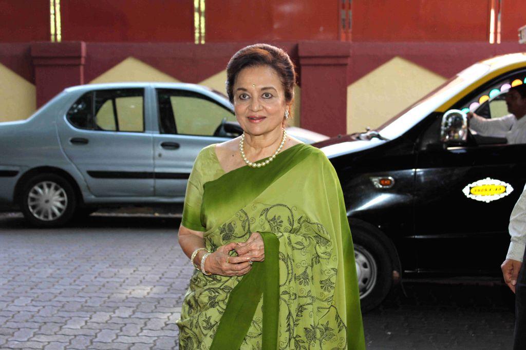 Mumbai: Actress Asha Parekh during the book launch of 4th Dimension written by Architect Chandrakant Patel, in Mumbai on Aug 23, 2015. (Photo: IANS) - Asha Parekh and Chandrakant Patel