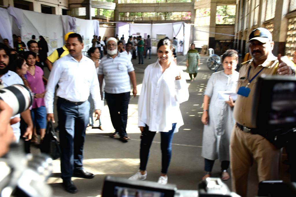 Mumbai: Actress Deepika Padukone shows her forefinger marked with indelible ink after casting vote during the fourth phase of 2019 Lok Sabha elections, in Mumbai on April 29, 2019. (Photo: IANS) - Deepika Padukone