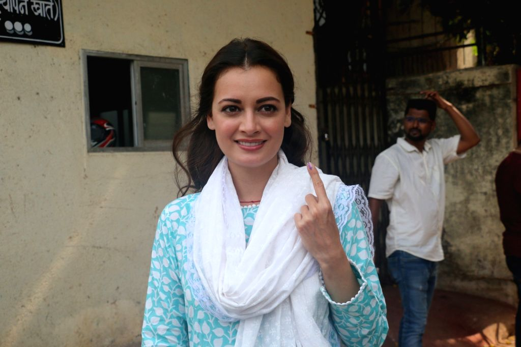 Mumbai: Actress Dia Mirza shows her inked finger after casting her vote for the fourth phase of 2019 Lok Sabha elections, in Mumbai on April 29, 2019. (Photo: IANS) - Dia Mirza