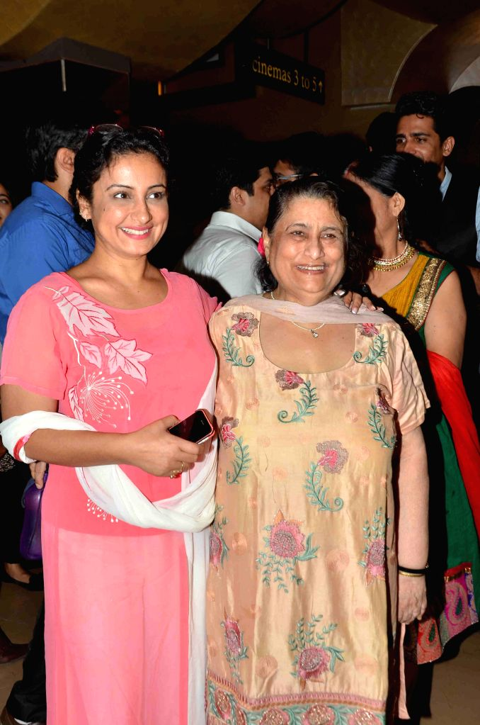 Actress Divya Dutta with her mother Nalini Dutta during the screening of film Dharam Sankat Mein in Mumbai on April 8, 2015. - Divya Dutta