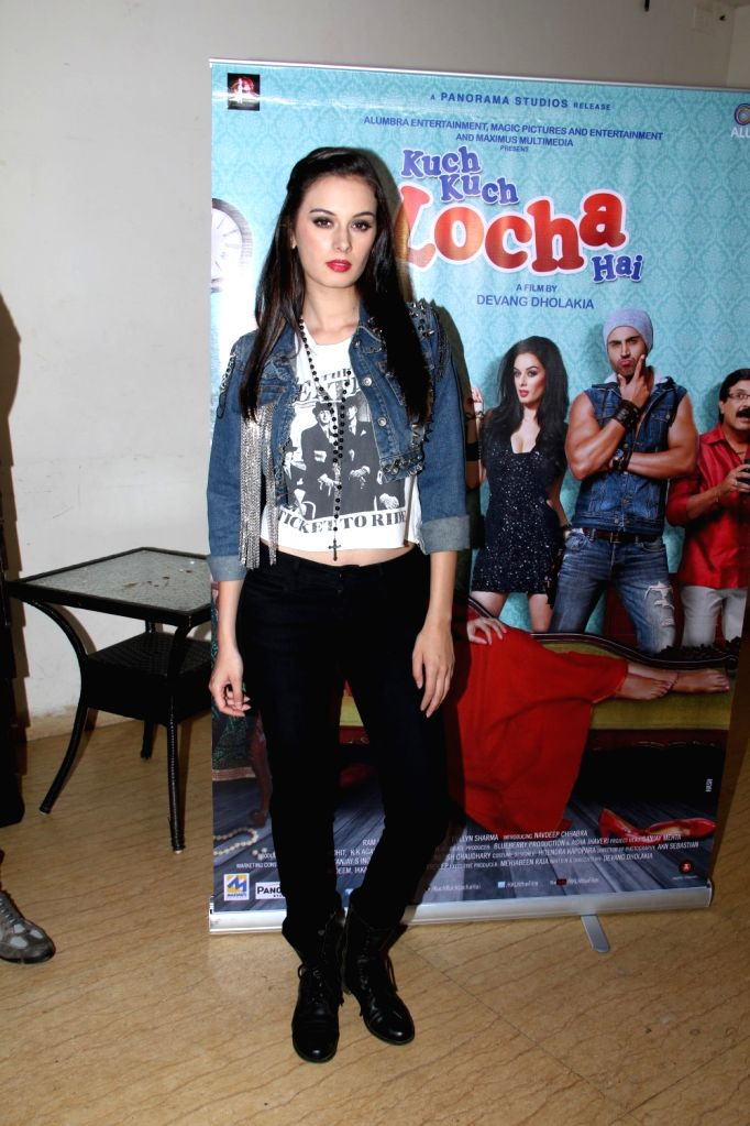 Actress Evelyn Sharma during a media interaction at the promotion of film Kuch Kuch Locha Hai in Mumbai. - Evelyn Sharma