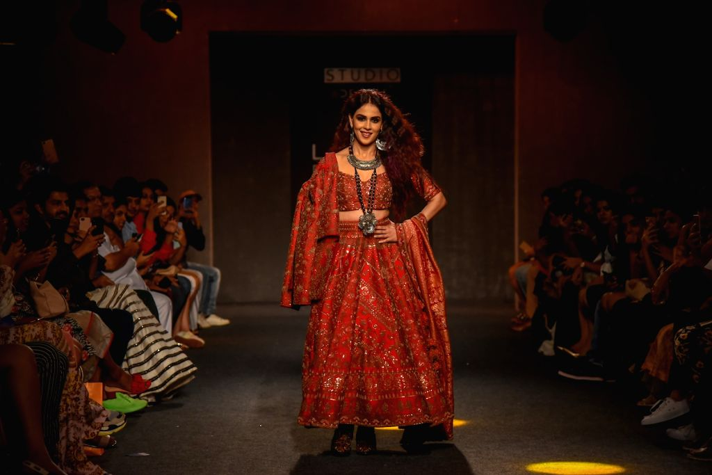 Mumbai: Actress Genelia Deshmukh walks the ramp for fashion designer Saroj Jalan on Day 5 of the Lakme Fashion Week Winter/Festive 2019 in Mumbai on Aug 25, 2019. (Photo: IANS) - Genelia Deshmukh