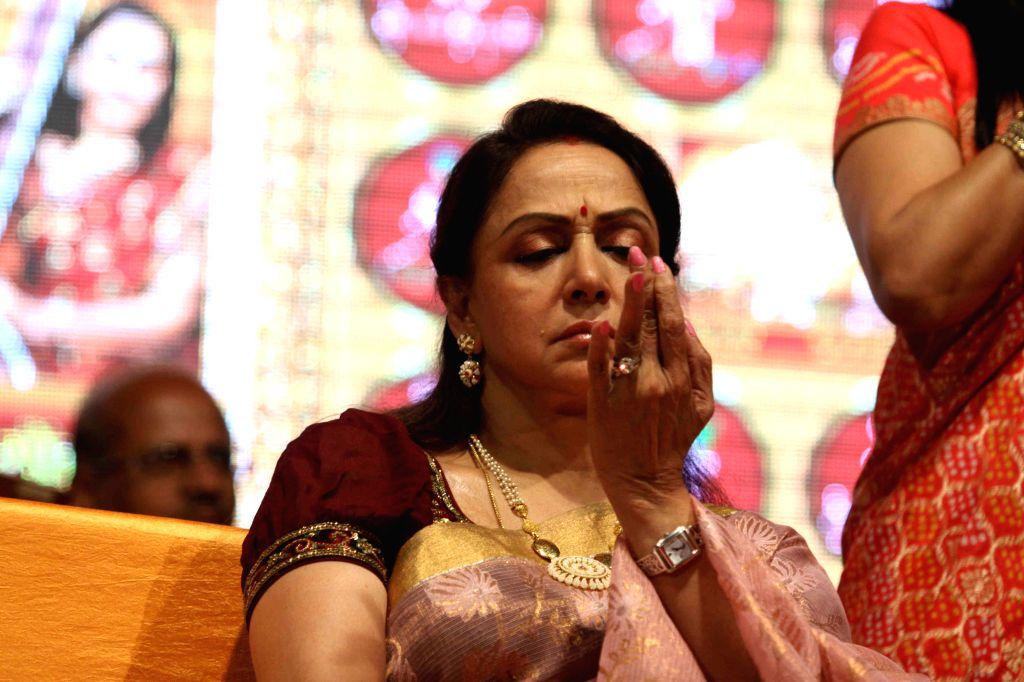 Actress Hema Malini during the launch of Dr.Veena Mundhra's Shri Hari Vani Gita devotional album and book in Mumbai on Feb 22, 2015. - Hema Malini