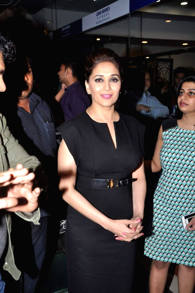 Actress Madhuri Dixit Nene during the book launch of Fitness expert Leena Mogre `Total Fitness`, in Mumbai, on April 30, 2015. - Madhuri Dixit Nene