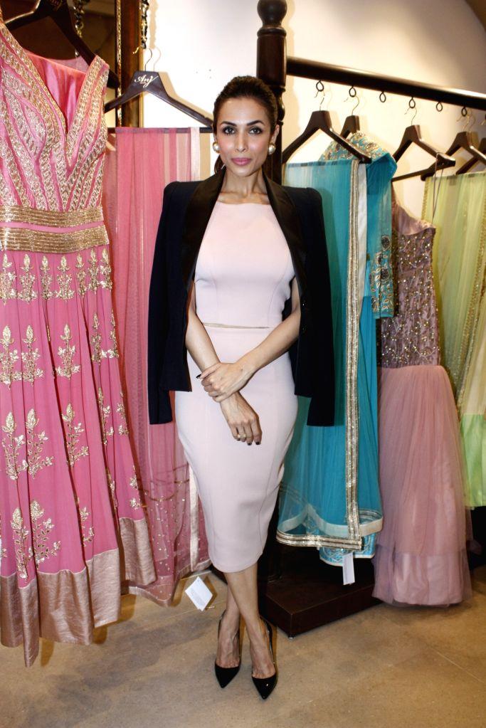 Actress Malaika Arora Khan during the launch of store Anj Kouture in Mumbai. - Malaika Arora Khan